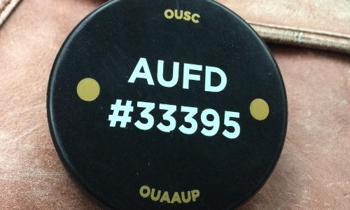 a hockey puck that was part of the Oakland University AAUP's fundraising campaign to provide classroom interior door lock